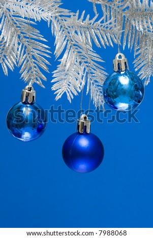blue Christmas balls on silver tree - stock photo