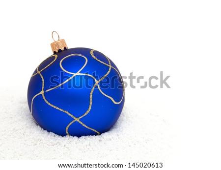 Blue Christmas balls on snow - stock photo