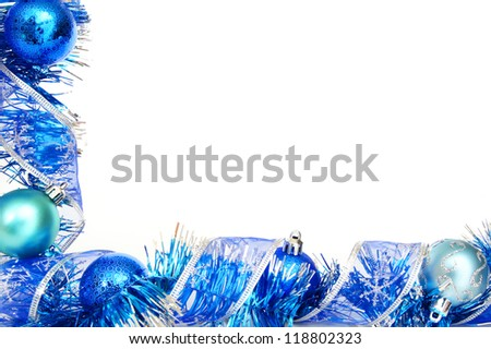 Blue Christmas border with baubles, garland and shiny ribbon over white - stock photo