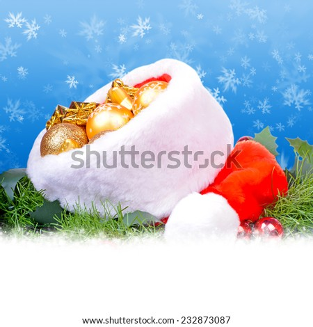 Blue christmas card with red Santa Claus hat - stock photo