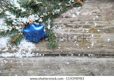 Blue Christmas decorations on a wooden background - stock photo