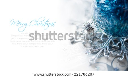 Blue christmas ornaments on bright holiday background with space for text. Merry xmas. - stock photo