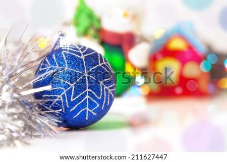 Blue Christmass ball with blury festive glitter lights background - stock photo