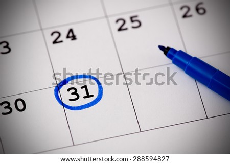 Blue circle. Mark on the calendar at 31. - stock photo