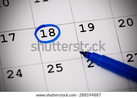 Blue circle. Mark on the calendar at 18. - stock photo