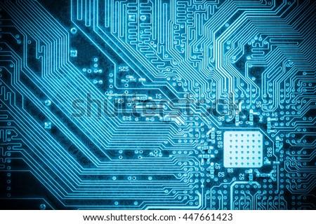 blue circuit board closeup, abstract high tech background - stock photo