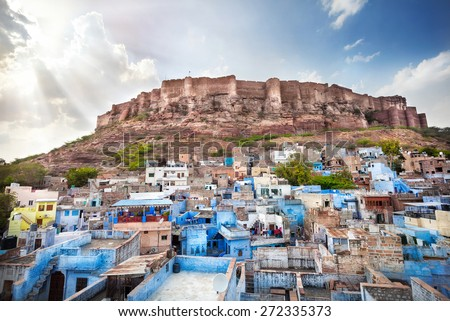 Blue city and Mehrangarh fort on the hill at sunset sky in Jodhpur, Rajasthan, India - stock photo