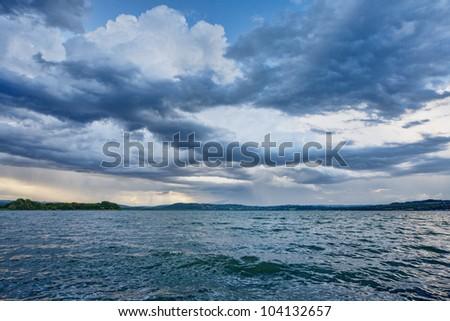 Blue cloudy dramatic sky - stock photo