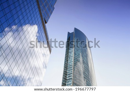 Blue cloudy sky reflection in the office building's windows  - stock photo