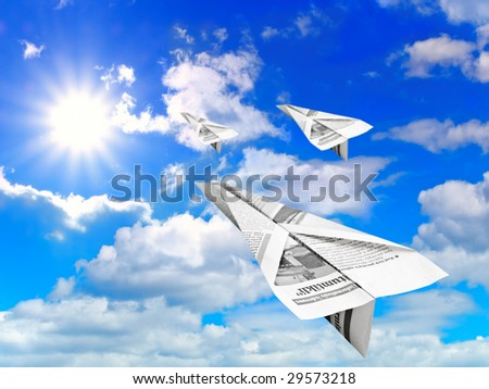 blue cloudy sky with sun and flying paper airplanes - stock photo