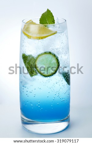 Blue cocktail on white background   - stock photo