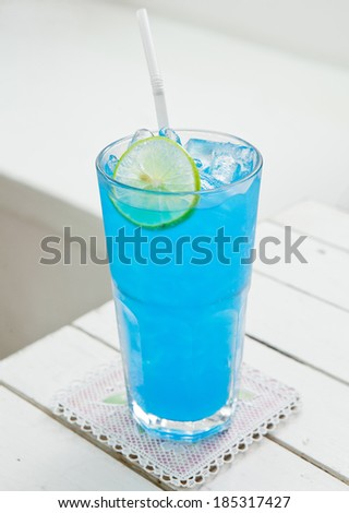 Blue Cocktail on White Table - stock photo