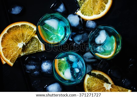 Blue cocktail with blue curacao liqueur and orange, top view, selective focus - stock photo