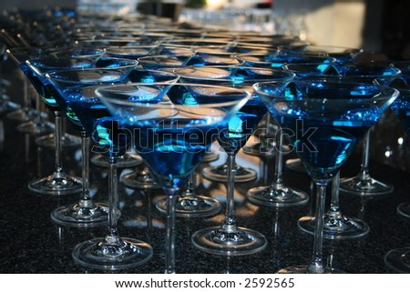Blue cocktails on table - stock photo