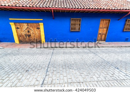 Blue colonial architecture in La Candelaria neighborhood in Bogota, Colombia - stock photo
