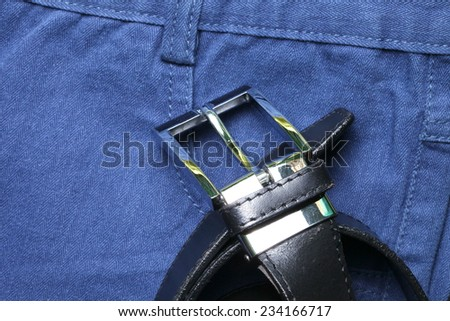 Blue color of short trouser made from herringbone patterned fabric style represent the applied synthetic cloth production in the scene appear the black color leather belt business style  also - stock photo