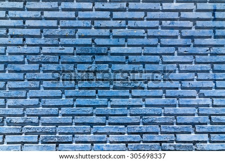 Blue color paint on old brick wall texture background. - stock photo