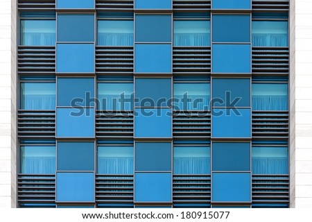 blue color windows of modern office building horizontal background - stock photo