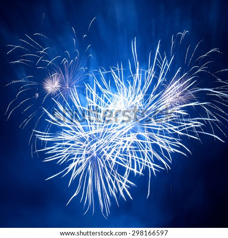 Blue colorful fireworks in heart shape on the black sky background. Holiday celebration. - stock photo