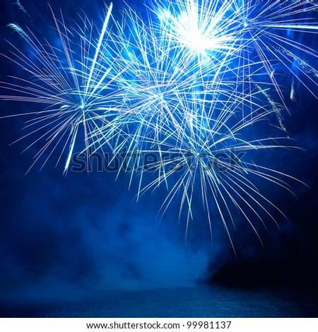 Blue colorful fireworks on the black sky background. Holiday celebration. - stock photo