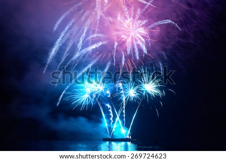 Blue colorful holiday fireworks on the black sky background. - stock photo