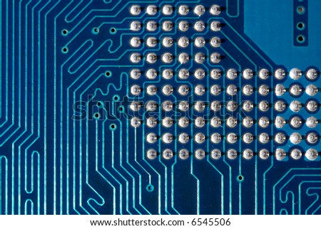 Blue computer motherboard with processor pins. Extremely close-up - stock photo