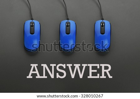Blue computer mouse and word answer -education concept .Low light - stock photo