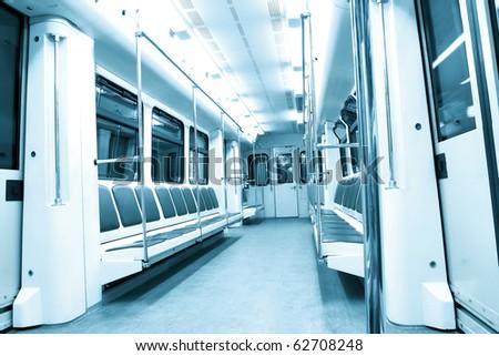 blue contemporary illuminated carriage interior - stock photo