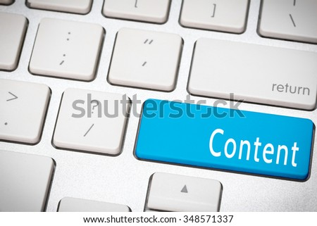 Blue content button on the keyboard - stock photo