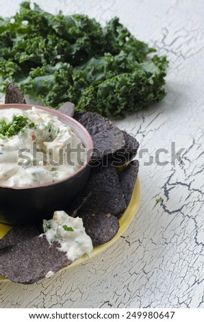 blue corn tortilla chips with ranch vegetable dip with kale - stock photo