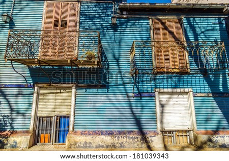 Blue corrugated siding of an old building in La Boca neighborhood of Buenos Aires, Argentina - stock photo