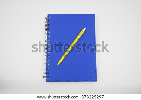 Blue cover notebook and pen on white background - stock photo