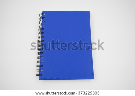 Blue cover notebook on white background - stock photo