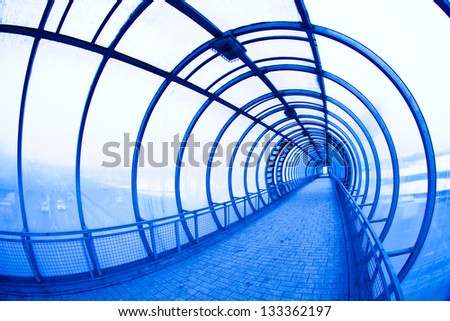 blue covered air bridge. Moscow City - stock photo
