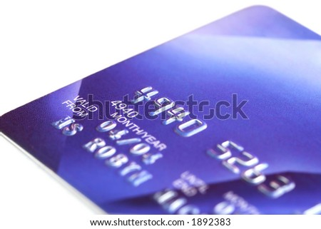 Blue credit card, with shallow DOF, white background - stock photo