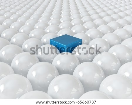 Blue cube among white spheres, standing out in the crowd concept - stock photo