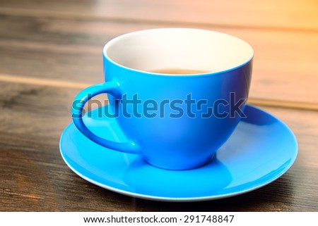 Blue cup of tea - stock photo