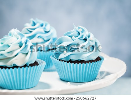 Blue Cupcakes on a plate. Vintage style. - stock photo