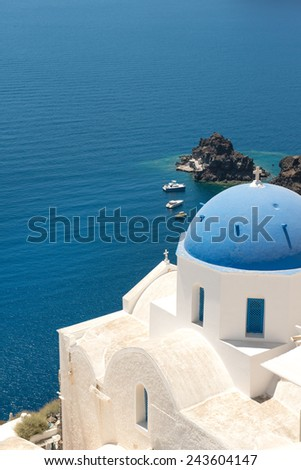 Blue cupola of whitewashed Oia church in Santorini - stock photo