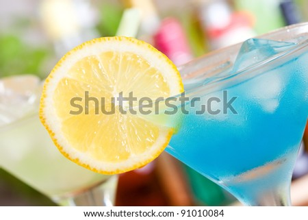 Blue Curacao cocktail with lemon - stock photo