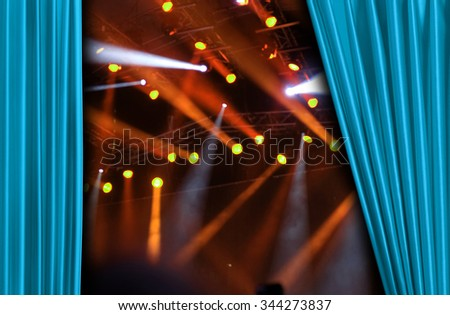 Blue curtain on concert stage slightly open - stock photo