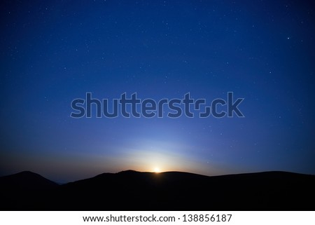 Blue dark night sky with many stars. Moon rising. Space background - stock photo
