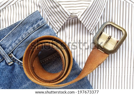 Blue denim jean with shirt and belt - stock photo