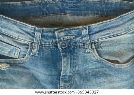Blue denim jeans pocket closeup, jeans texture background - stock photo