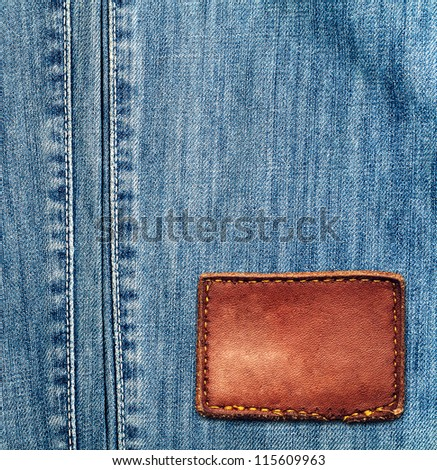 Blue denim jeans texture with empty label - stock photo