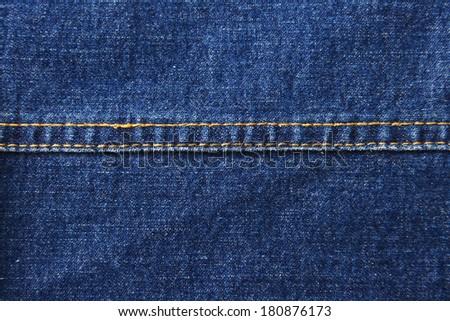 Blue denim  texture with seam - stock photo