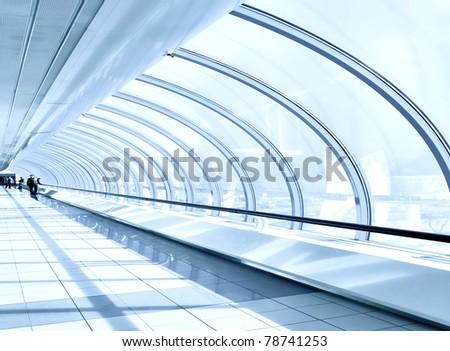 blue diminishing hall inside metro station - stock photo