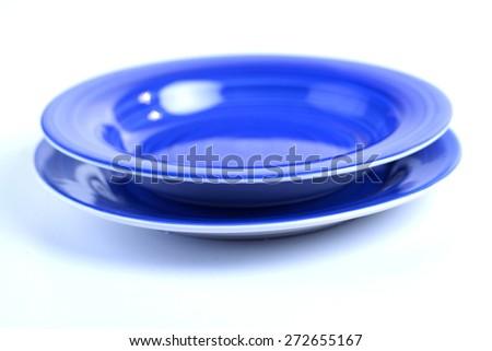 Blue dishes on white background - stock photo