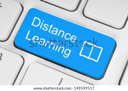 Blue distance learning button on white keyboard  - stock photo