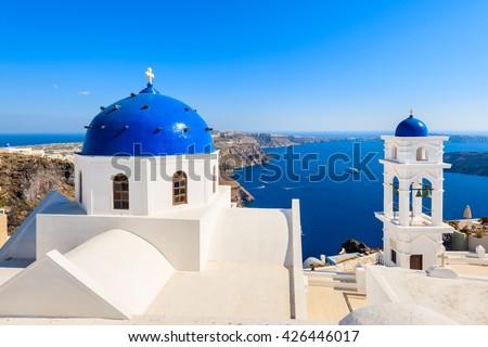 Blue dome of church in Imerovigli village and view of blue sea with caldera on Santorini island, Greece - stock photo